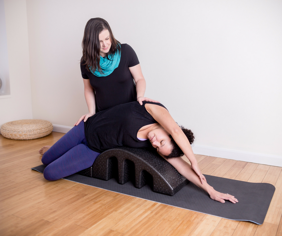 Brigitte Arle of Rooted Boston showing yoga position